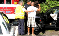 July 24, 2012 - No one was injured when this car struck a mail box and guard rail at 32 East Main Street.© Dick Bartlett