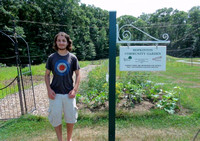 August 7, 2012 - Eagle Scout Max Vumbaca poses in front of the Hopkinton Community Garden he created for his Eagle Scout project. Tune in to HCAM News Friday at 6PM to learn more! © Michelle Murdock
