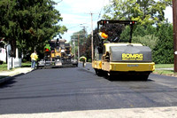 August 6, 2012 - A crew was working on the final finish coat of pavement on Church Street. © Dick Bartlett