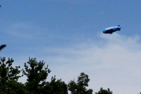 August 6, 2012 - The DirecTV blimp was flying over Woodville. This picture was taken from Patriots Blvd. © Dick Bartlett