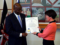 Rep. Carolyn Dykema presents Ambassador Odembo with proclamation from the House of Representatives.