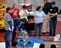 February 6, 2012 - Members of the HHS team prepare the robot (#4392) for a match.Photo by HHS Robotics Team