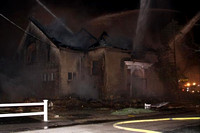 April 15, 2011 - Mutual aid came from 12 fire departments, including Hopkinton, for a 5 Alarm blaze that destroyed a vacant masonic Lodge in Franklin.© Douglas Dow