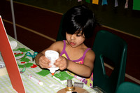 Anushka Dattar is busy at the arts and crafts table sponsored by  Sparks Art Studio.© Michelle Murdock