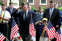 Veteran Russ Greve and Cub Scout Thomas Mirabile salute at the Evaargreen cemetary ceremony.Photo by Dick Bartlett