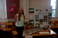 Tess Morningstar displays her project which shares her experience working at an organic vegetable farm.