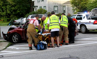 June 24, 2012 - One person was injured and transported to the Milford hospital following a one car crash at Maple and Grove Streets at about 7 PM.© Dick Bartlett