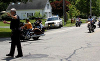 "June 23, 2012 - The first annual Holliston Police "" K9 Motorcycle Kruise "" traveled through Hopkinton on Saturday . Officer Pat O'Brien assisted at the corner of Hayden Row and Chestnut.© Dick Bartl"