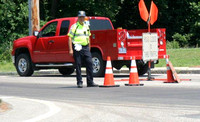 June 22, 2012 - Traffic Detail Officer Bob Bartlett on duty in 93 degree weather while a construction crew paved Elm Street.© Dick Bartlett