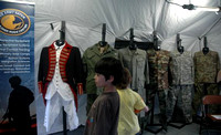 April 15, 2012 - Looking at the uniform display in the US Army tent on the Town Common. More photos at Scene In Hopkinton.© Michelle Murdock