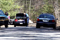 March 11, 2012 - State Police search the vehicle that was stopped when the driver fled into the woods near Rt 495.© Dick Bartlett