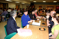 Dottie Ferriter of the Hopkinton Marathon Committee talks with students at the Government Breakfast on March 23, 2012.
