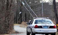 January 13, 2012 - Two utility poles and wires came down on Curtis Road at about noon . NStar and Verizon were called for repairs.© Dick Bartlett