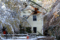 October 30, 2011 -  A house was severly damaged on Cross Street after a large tree fell on it during the storm.   photo by Dick Bartlett