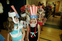 June 10, 2011 - Students at Center School file into the gym for their Flag Day celebration. © Michelle Murdock