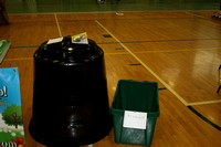 A composter and a recycling bin on display at the HPTA Green Expo.