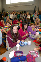 Girls Scouts make knitted hats for Medway Family Shelter.