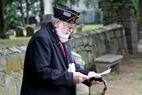 American Legion Post Chaplin Richard Brault speaks at the Evergreen cemetary in Woodville.Photo by Dick Bartlett