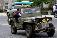 Veteran David Beattie rides in an antique military jeep. Photo by Dick Bartlett