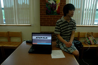Tony Gao sits patiently and waits to explain the application he developed for Bose Corporation during his internship.