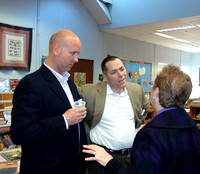 School committee member Troy Mick and Superintendent Jonathan Landman talk to Elmwood Principal Ilene Silver before heading out to read duriing Community Reading Day.