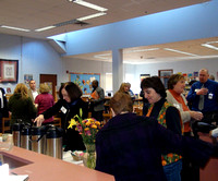 Community readers gather in the Elmwood library for coffee and refreshments before heading to classrooms to read.