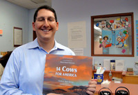 "School committee member Scott Aghababian will be reading ""14 Cows for America""."