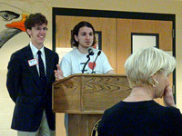 Tyler Mikulis and Max Vumbaca pay tribute to Nancy Clark.